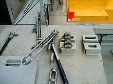 Manual Twistlock used in locking containers on vessels (Wikipedia)